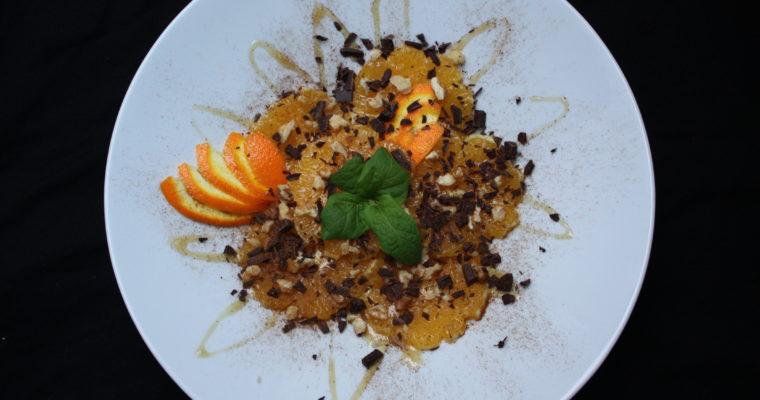 Appelsindessert med valnøtter, mynte og mørk sjokolade